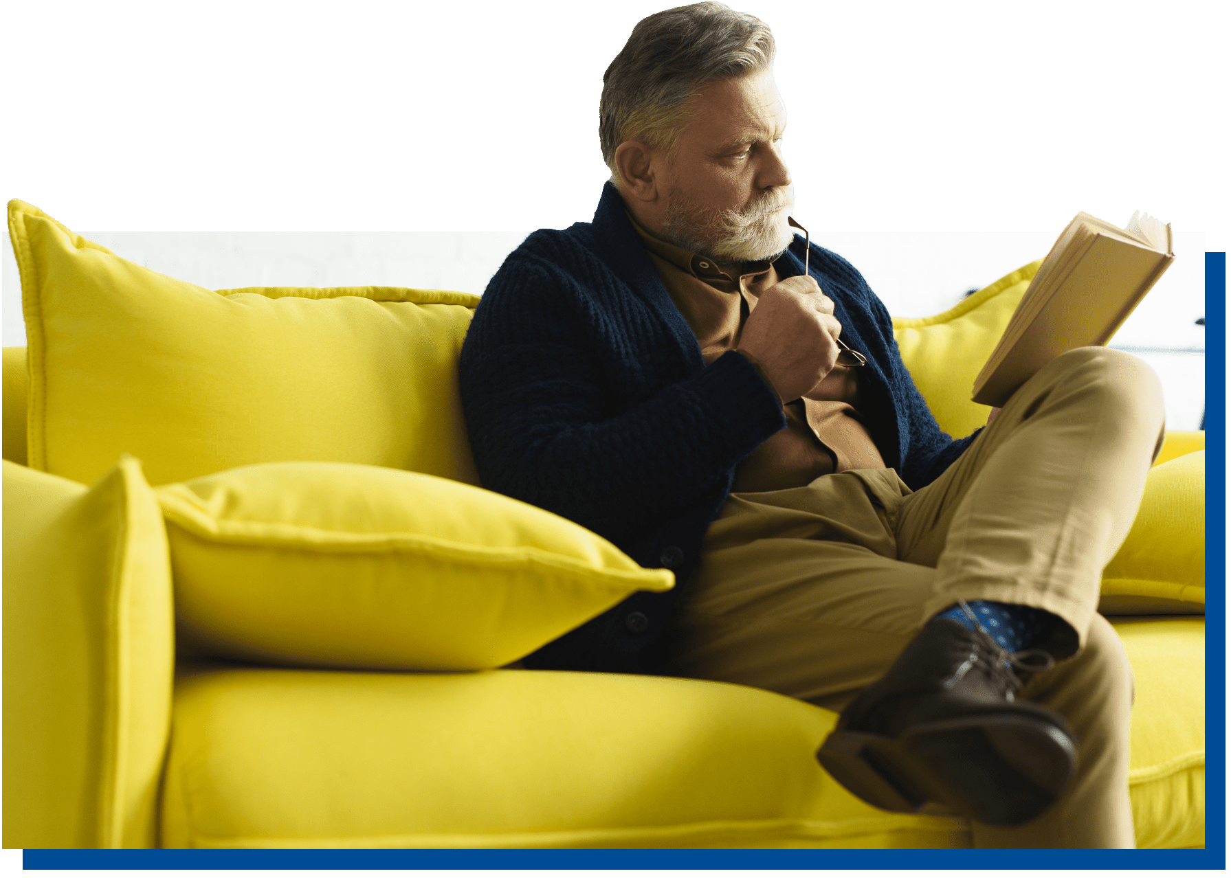 Man reading book on couch