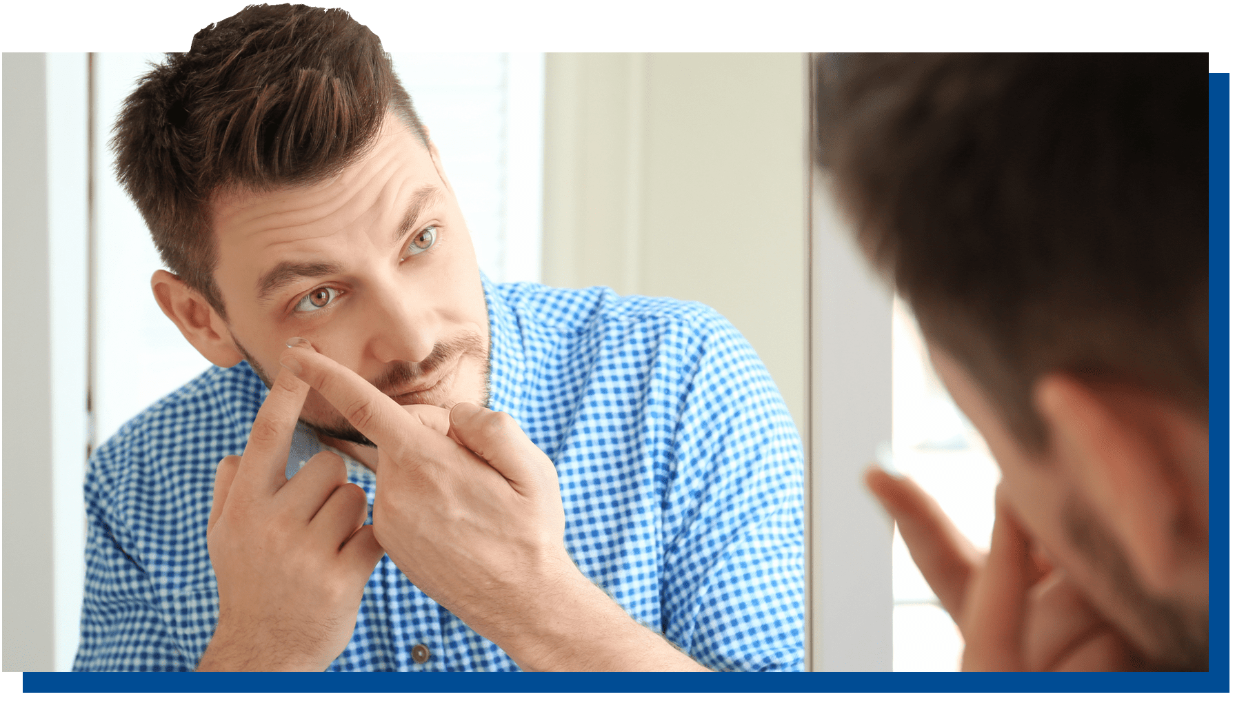 Young man putting in contacts