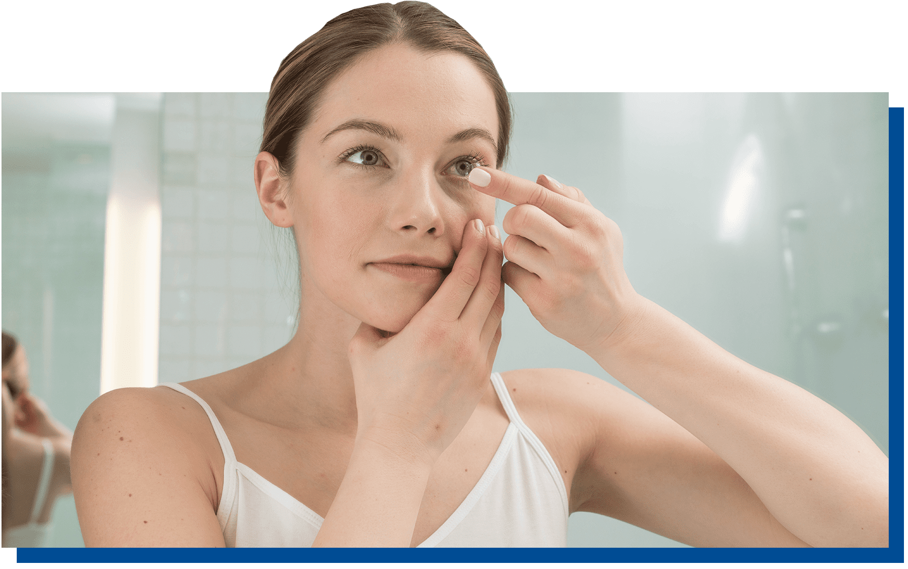 Woman putting contacts in