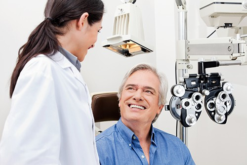 Man talking to opthamologist